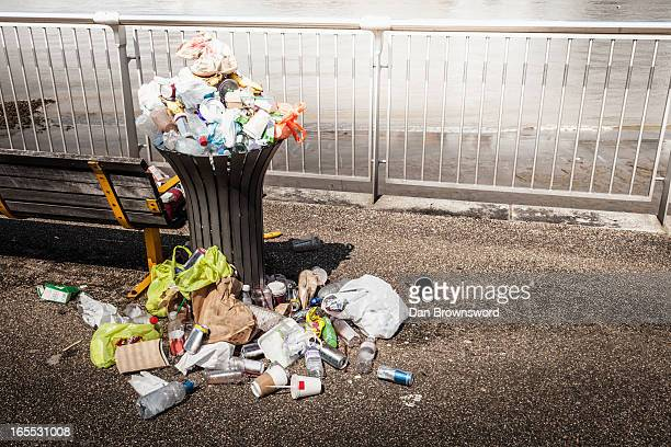 trash overflowing from bin - garbage can stock photos and pictures