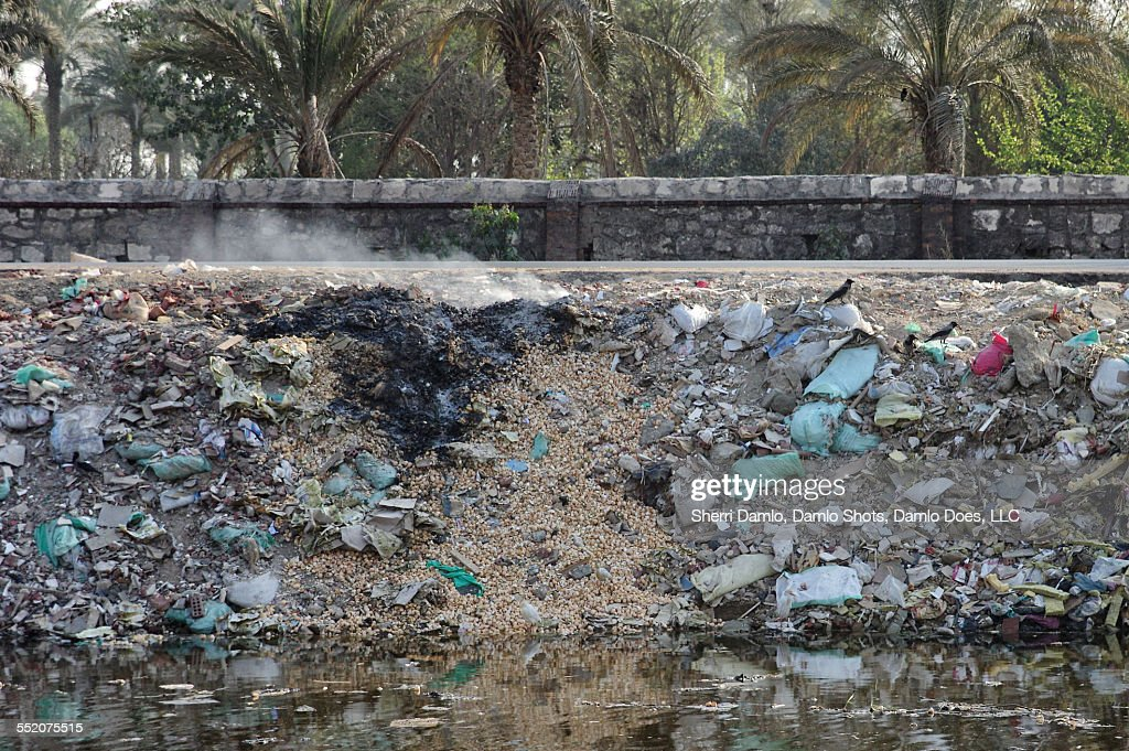 Trash pile on fire in Cairo : Stock Photo