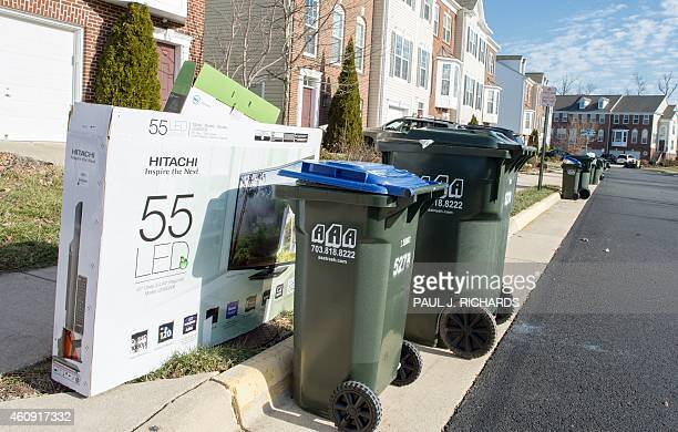 Trash sits at the curb for pickup on the first trash day after Christmas December 30 in Centreville Virginia Home security experts suggest tearing...
