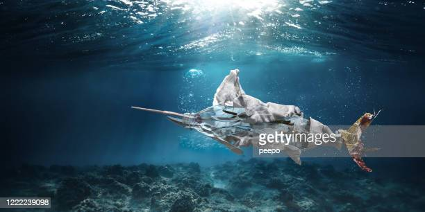 trash underwater in ocean in shape of marlin swordfish - packaging stock pictures, royalty-free photos & images
