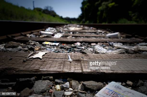 Trash-strewn railroad track used by drug addicts