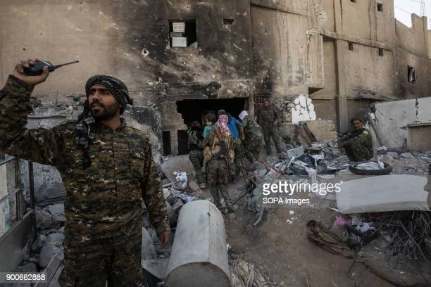 A traumatised girl rescued by SDF fighters She and her family were being held hostage near the stadium of Raqqa She lost her parents While they were...