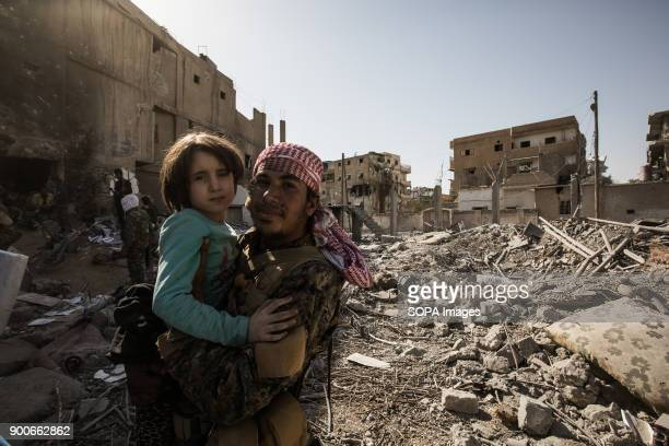 A traumatized girl rescued by SDF fighters She and her family were being held hostage near the stadium of Raqqa She lost her parents While they were...