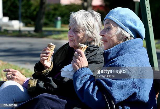 Trautel Brown left and Deborah Gorsline enjoy what they called their last ice cream of the season on a bench overlooking Manchester Harbor at...