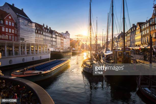 traval cruise with tourist in canal at Nyhavn, colorful building