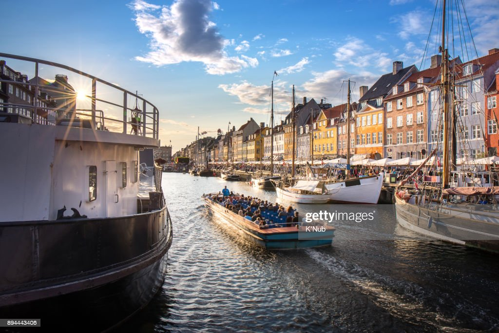 traval cruise with tourist in canal at Nyhavn, colorful building : Stock Photo