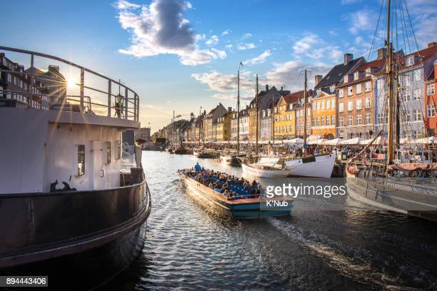 traval cruise with tourist in canal at nyhavn, colorful building - copenhagen stock pictures, royalty-free photos & images