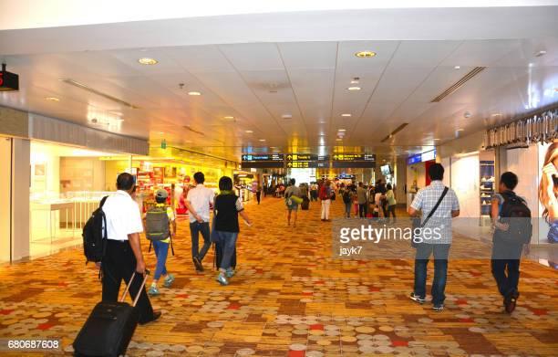 Travalers walking inside the airport