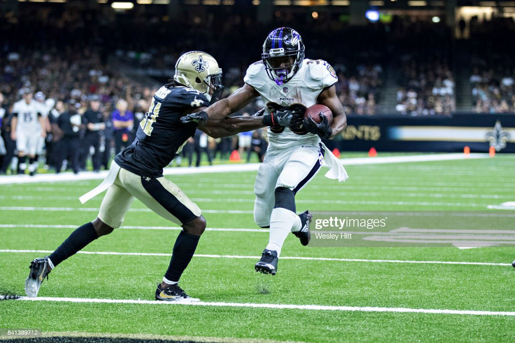Travaris Cadet #38 of the Baltimore Ravens runs the ball for a touchdown against Lardarius Webb #21 of the New Orleans Saints at Mercedes-Benz Superdome on August 31, 2017 in New Orleans, Louisiana. The Ravens defeated the Saints 14-13.