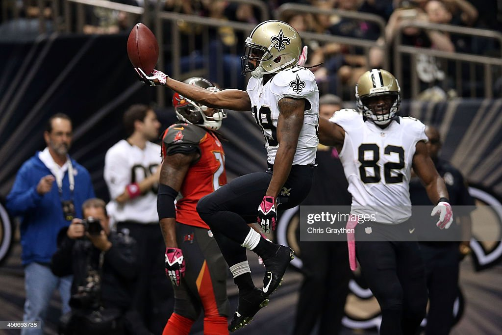 Travaris Cadet #39 of the New Orleans Saints reacts to a touchdown during the third quarter of a game against the Tampa Bay Buccaneers at the Mercedes-Benz Superdome on October 5, 2014 in New Orleans, Louisiana.