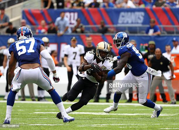 Travaris Cadet of the New Orleans Saints runs the ball against Jason PierrePaul of the New York Giants during the first half at MetLife Stadium on...