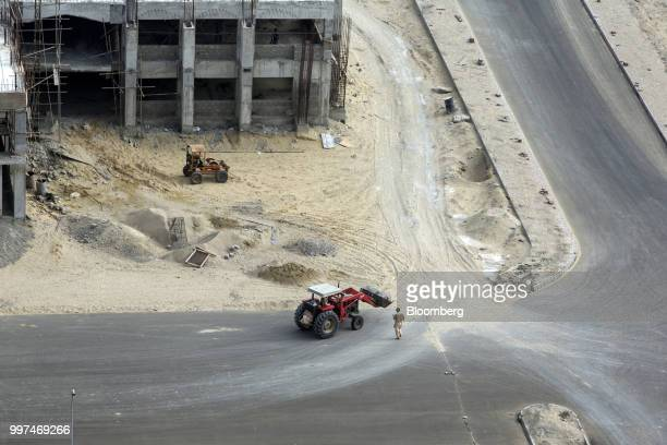 A travator operates at a development site operated by China Overseas Ports Holding Co near Gwadar Port in Gwadar Balochistan Pakistan on Tuesday July...