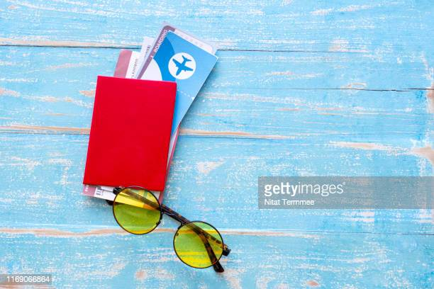 travel accessories costumes. passport and flight tickets. travel prepared for the summer trip. - travel destinations stock pictures, royalty-free photos & images