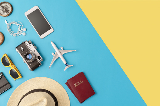 Travel accessories flat lay with copy space 1045469854