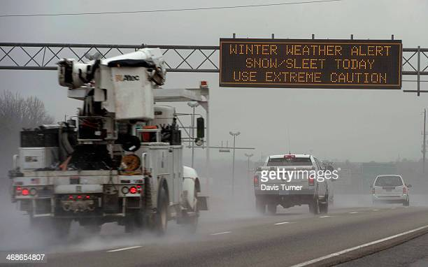 A travel advisory sign along I85 South warns drivers of hazardous driving conditions as a winter storm approaches on February 11 2014 in Atlanta...