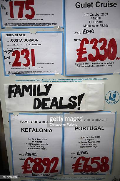 A travel agent advertises last minute holiday deals in its window on August 10 2009 in Manchester England As the British weather continues to be...