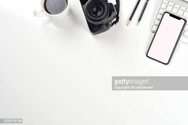 travel agent work desk with dslr camera, mobile phone flat lay travel and tourism concept - website template stock photos and pictures