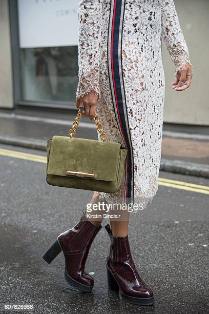 Travel and Fashion Blogger Bonnie Rakhit is wearing dress by Pinko shoes by Kurt Geiger bag by Amanda Wakeley day 1 of London Womens Fashion Week...