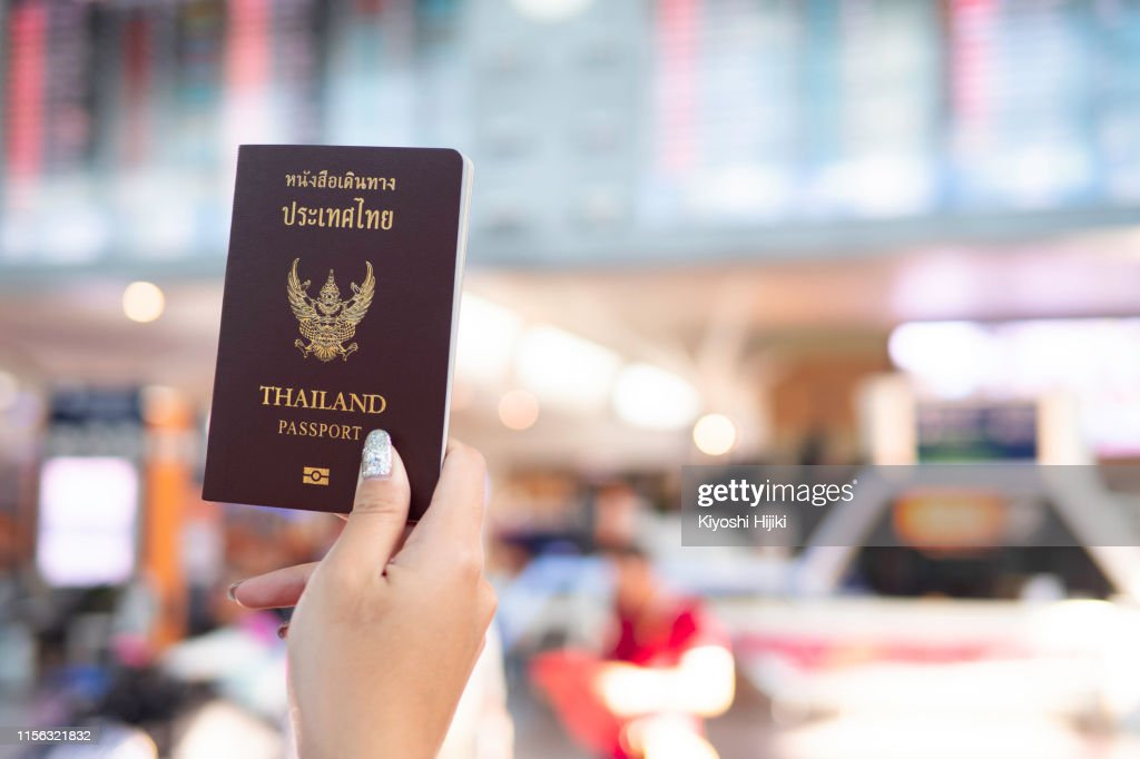 Travel And Holiday Concept Hand Holding Thai Passport