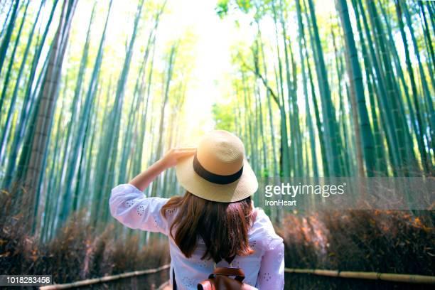 travel at arashiyama bamboo forest in kyoto. - arashiyama stock pictures, royalty-free photos & images
