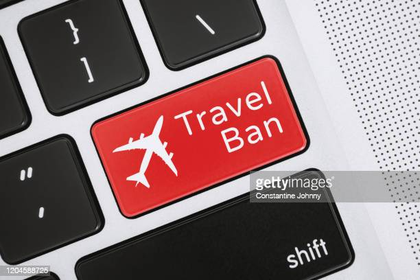 travel ban word and airplane icon on close-up computer keyboard key - travel ban stock pictures, royalty-free photos & images
