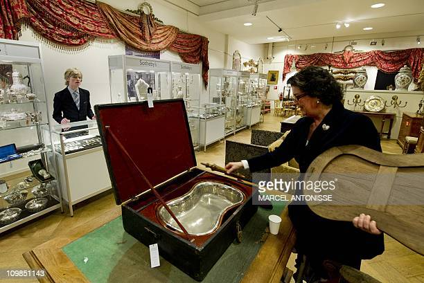 Travel bidet of late Dutch Queen Emma is shown by an employee at Sotheby's auction house in Amsterdam, on March 7, 2011. More than 10.000 objects...