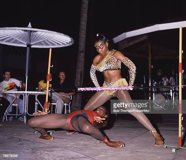 Travel Bridgetown Barbados Caribbean West Indies Tourists watching two local Limbo Dancers