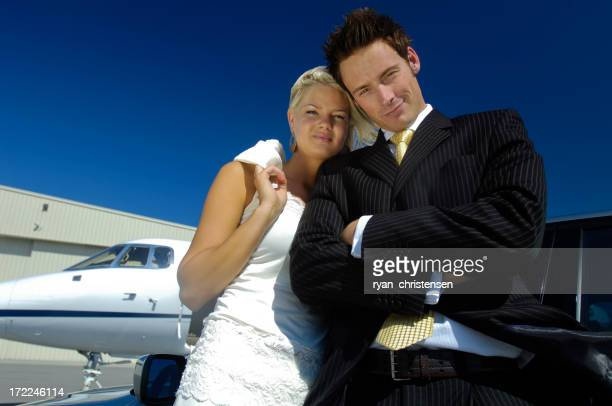 Travel - Businessman and woman next to private jet