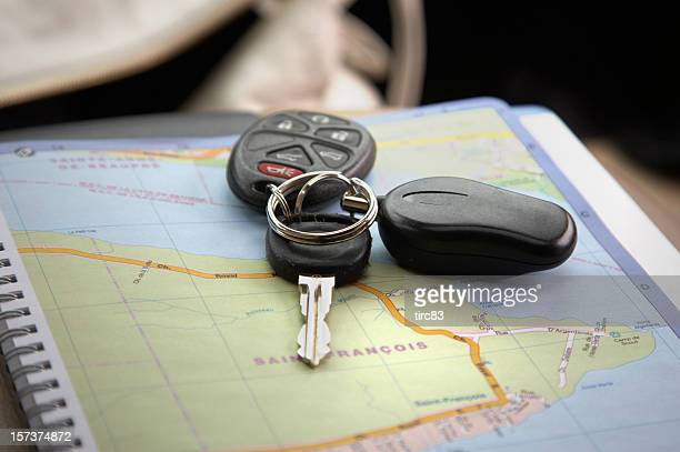 Travel car keys on map