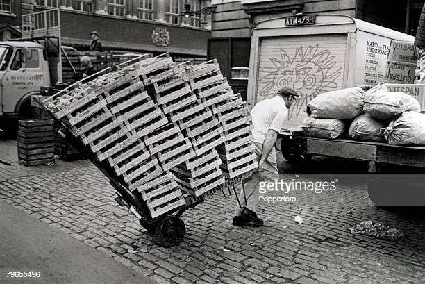 Travel Cities England London Occupations pic 3rd August 1972 A Covent Garden porter pulls his trolley laden with boxes of Italian peaches through the...
