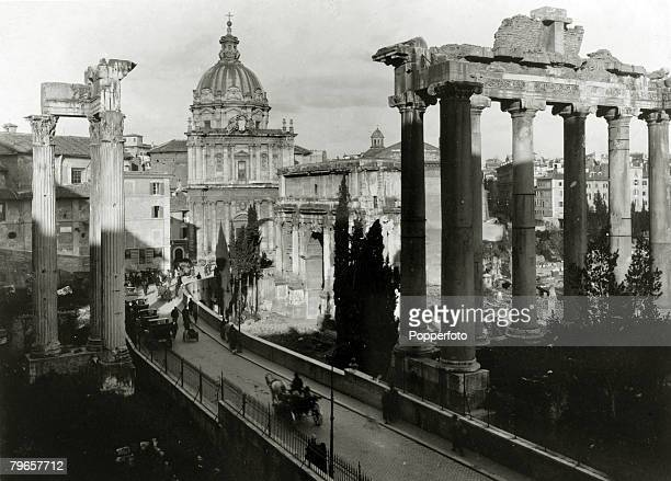 circa 1920 The Roman Forum showing on the left of the Sacra Via the Temple of Vespasian and on the right the Arch of Septimus Severus and the Temple...