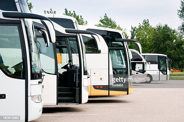 Travel coaches at tourist destination, parked in a row