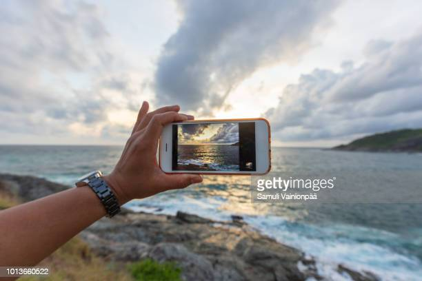 travel destination: promthep cape, phuket, thailand - photo messaging stock pictures, royalty-free photos & images