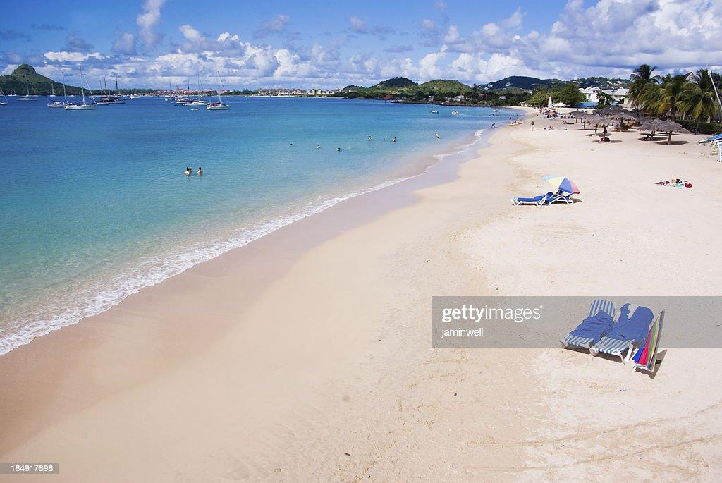 travel destination; turquoise beach and tourists resort : Stock Photo