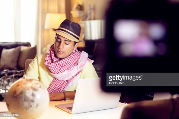 Travel enthusiast vlogger reading his notes during a recording session
