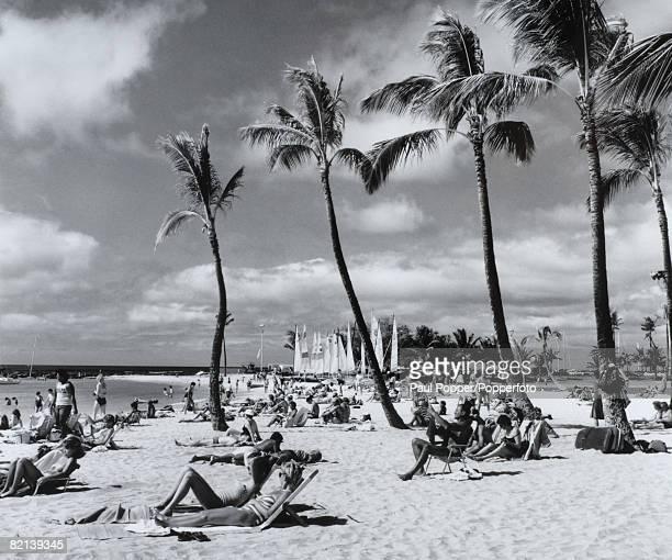 Travel Hawaii USA Waikiki Beach Circa 1970's A packed beach with people sunbathing and enjoying the sea