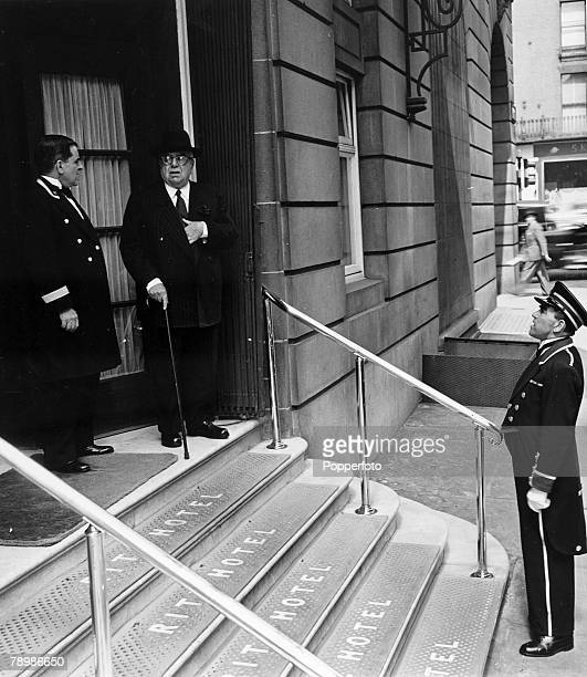 1950 London England HH Aga Khan pictured on the steps of the Ritz Hotel at the Arlington Street entrance with the Head Porter Georges Favoutakis
