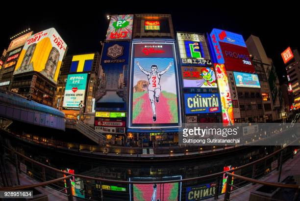 Travel in OSAKA, JAPAN The Glico Man billboard and other light displays  in Dontonbori, Namba Osaka area, Osaka, Japan. Namba is well known as an entertainment area in Osaka.