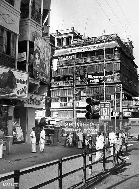 1962 Street scene in Calcutta a decade or so after Independence showing the garish posters of the Indian film industry