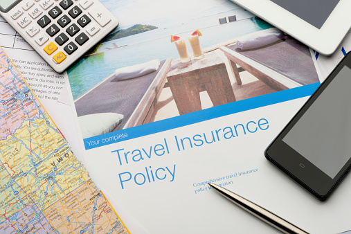 Travel insurance brochures and magazines. 531661855