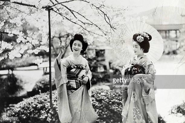 """Travel, Japan, Circa 1900's, Two Japanese Geisha girls, These Geisha's, known as """"Maikos"""", a special name given to Geisha of the city of Kioto, Seen..."""