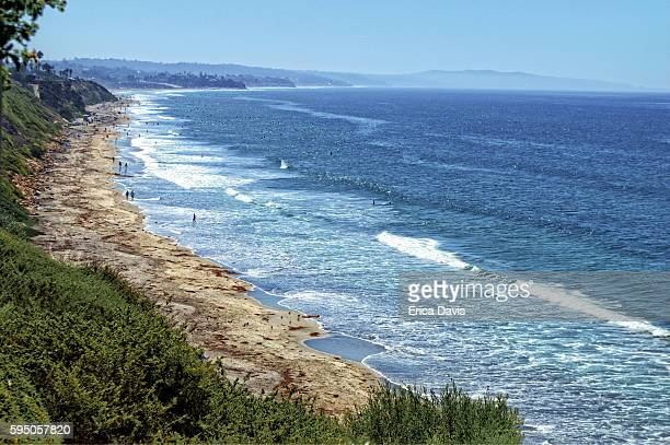 travel like a local - brief- view of people on carlsbad beac. - carlsbad california stock pictures, royalty-free photos & images