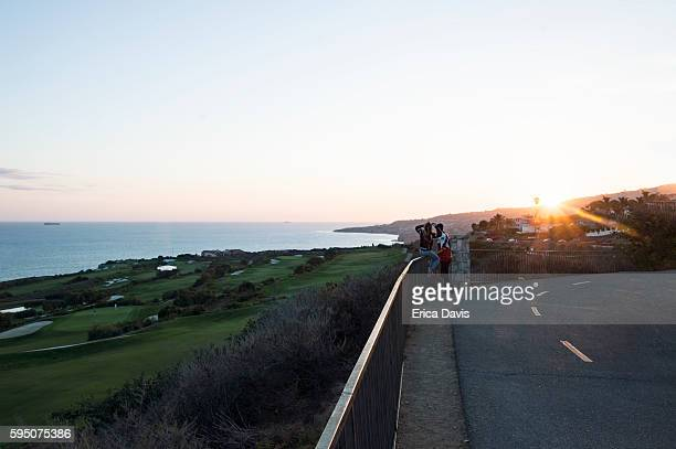 travel like a local - brief- young people take selfies at terranea resort. - rancho palos verdes stock pictures, royalty-free photos & images