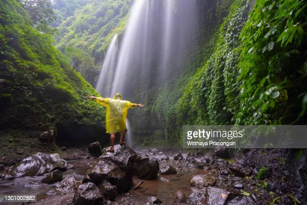 travel man adventure and standing relaxation at madakaripura waterfall east java,indonesiaindonesia - indonesia stock pictures, royalty-free photos & images
