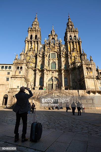 Travel man taking photo to cathedral of Santiago