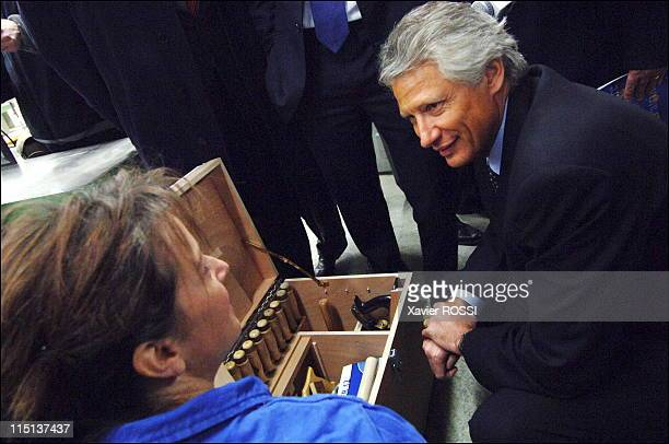 Travel of Dominique de Villepin, accompanied by Francois, Mayor of Troyes and Minister of Overseas in Troyes, France on February 03, 2006 - Visiting...