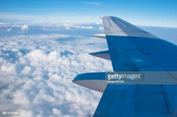 Travel on the jet plane or airplane from the window see the clound and sky. Travel concept.