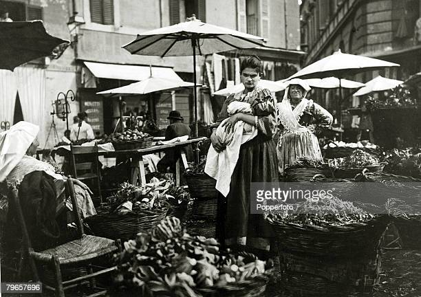 Travel People Cities Italy Rome pic 1890 A local woman cradles her baby at the vegetable and flower market in Rome