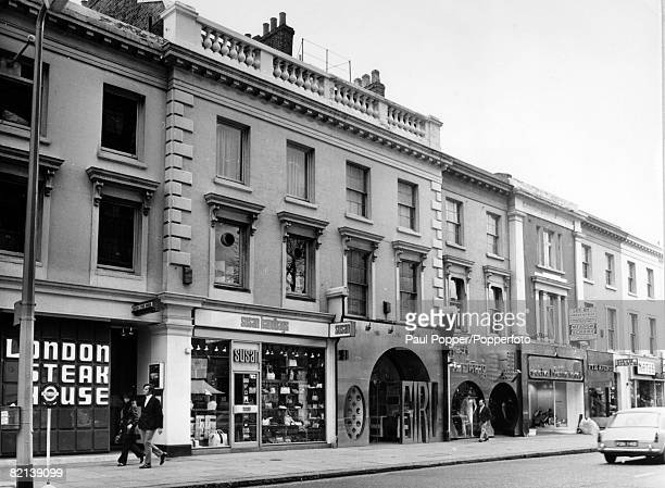 1968 Street scene and shops in the Kings Road Chelsea London