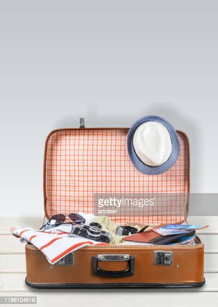 retro tourist luggage with colorful clothes